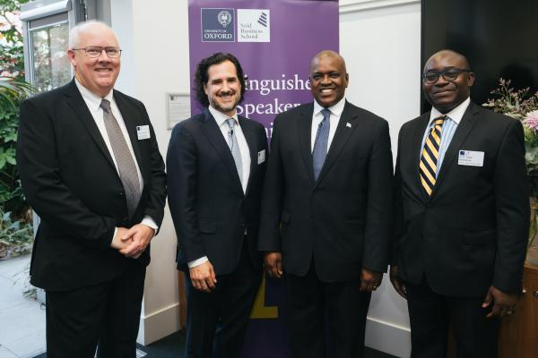 head of osga professor tim power dr peter drobac director of the skoll centre said business school president masisi of botswana and prof wale adebanwi of asc